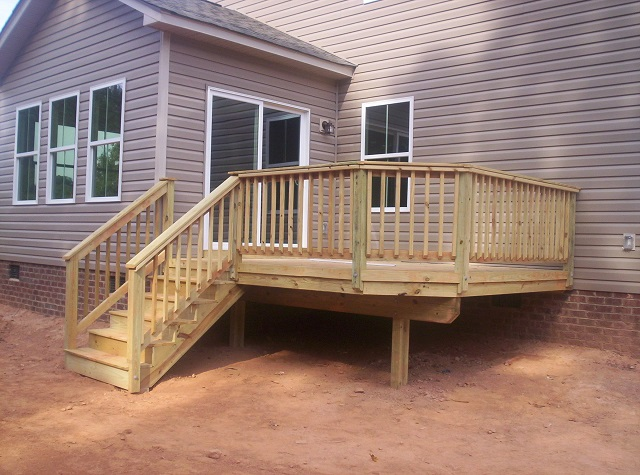 Pressure treated pine as use on central sc decks custom for Brown treated deck boards