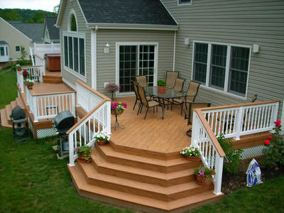 Composite deck with spa deck by Archadeck