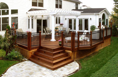 Elegant deck, pergola and patio by Archadeck