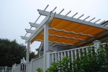 The owners of this pergola added a canopy to shade the sun