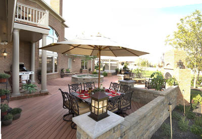 Artful incorporation of stonework with a composite deck