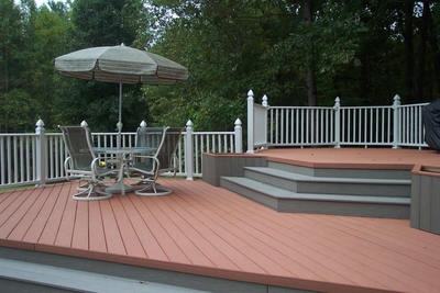 Composite deck accented w gray trim & white rail