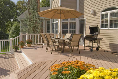 Composite deck with composite rail and flared stairs.