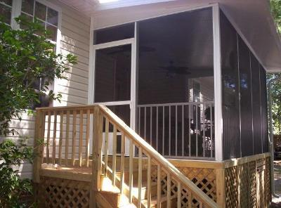 Pressure treated deck and aluminum screened porch in Lake Carolina by Archadeck of Central S.C.