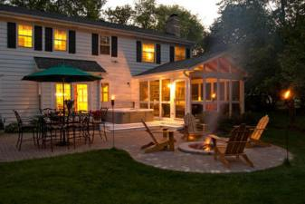 Screened Porch, Spa and Fire Pit at Dusk