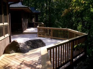 This spacious pressure treated deck in Columbia, SC overlooks the tranquil Saluda river.