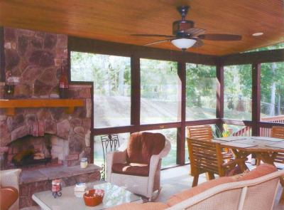 Columbia, SC three season room with rustic beadboard ceiling, ample dining and seating areas complete with a cozy outdoor fireplace.
