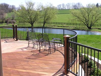 IPE deck with curve makes a statement and creates a great area, out of traffic pattern, to enjoy the great view. Powder coated black rail minimizes the intrusion on the view.