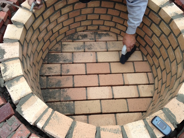 Columbia sc fire pit builder custom decks porches for Brick fire pit construction