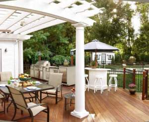 Deck with kitchen and pergola and ample pull out room for outdoor furnishings