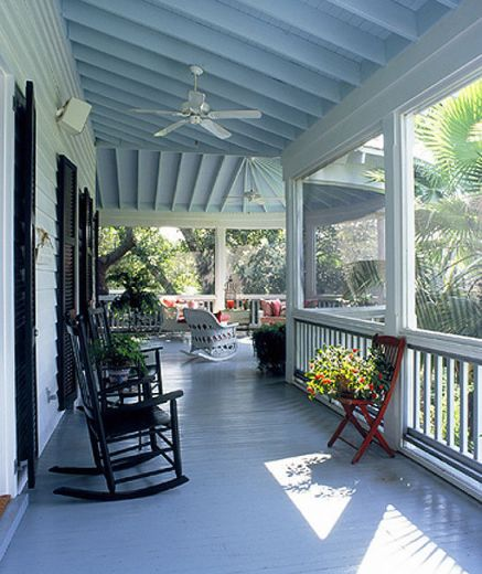 Beautiful porch with blue ceiling.