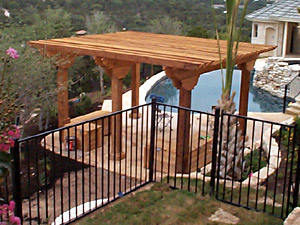 Poolside heavy timber pergola offers refuge
