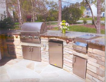 Rustic inspired outdoor kitchen with stone and granite combination.