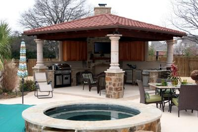 This outdoor living space includes a custom outdoor kitchen, perfect for grilling fish!