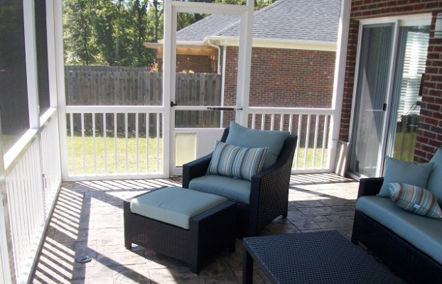 Aluminum screened porch over stamped concrete patio.